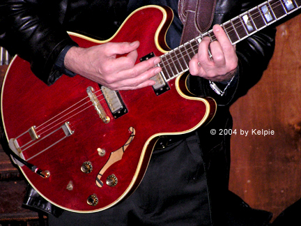 Drake's hands on the Epiphone