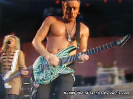 Phil Collen with Rick Savage in the background